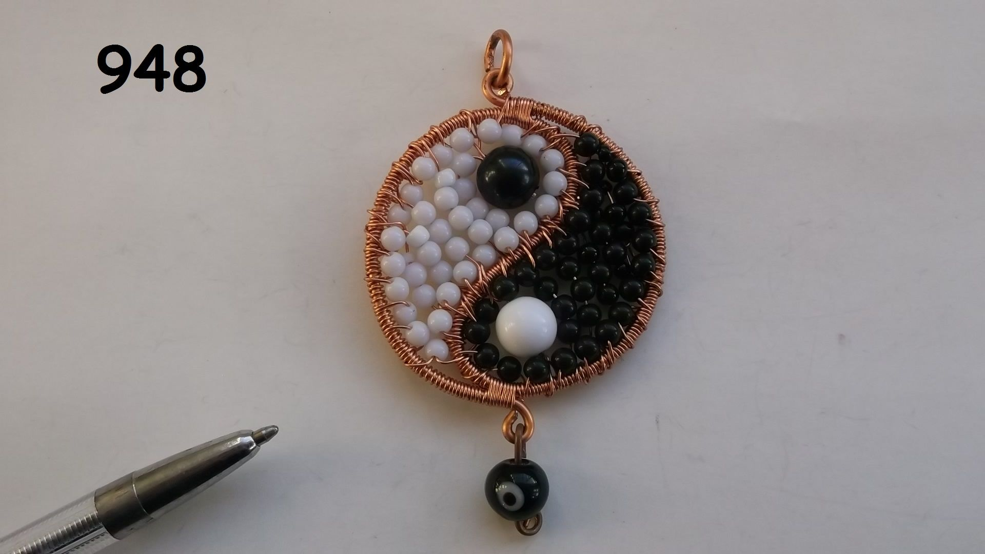 No.948 - a Yin & Yang pendant made from wire and beads - black and ...