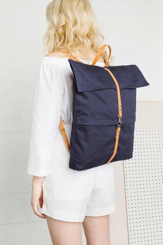 Handmade dark blue cotton backpack 2 inside pockets & 2 external pockets 100% cotton Lining (White and blue stripes): 100% cotton Handle and straps: Genuine leather  Height: 42cm / 16,5'' Width: 40cm / 16'' Depth: 6cm / 2,5''   If you live in Montreal (Qc, Canada) and you wish to pickup your purchase at our workshop, please contact us before ordering through Etsy!  <3 genreDenis.