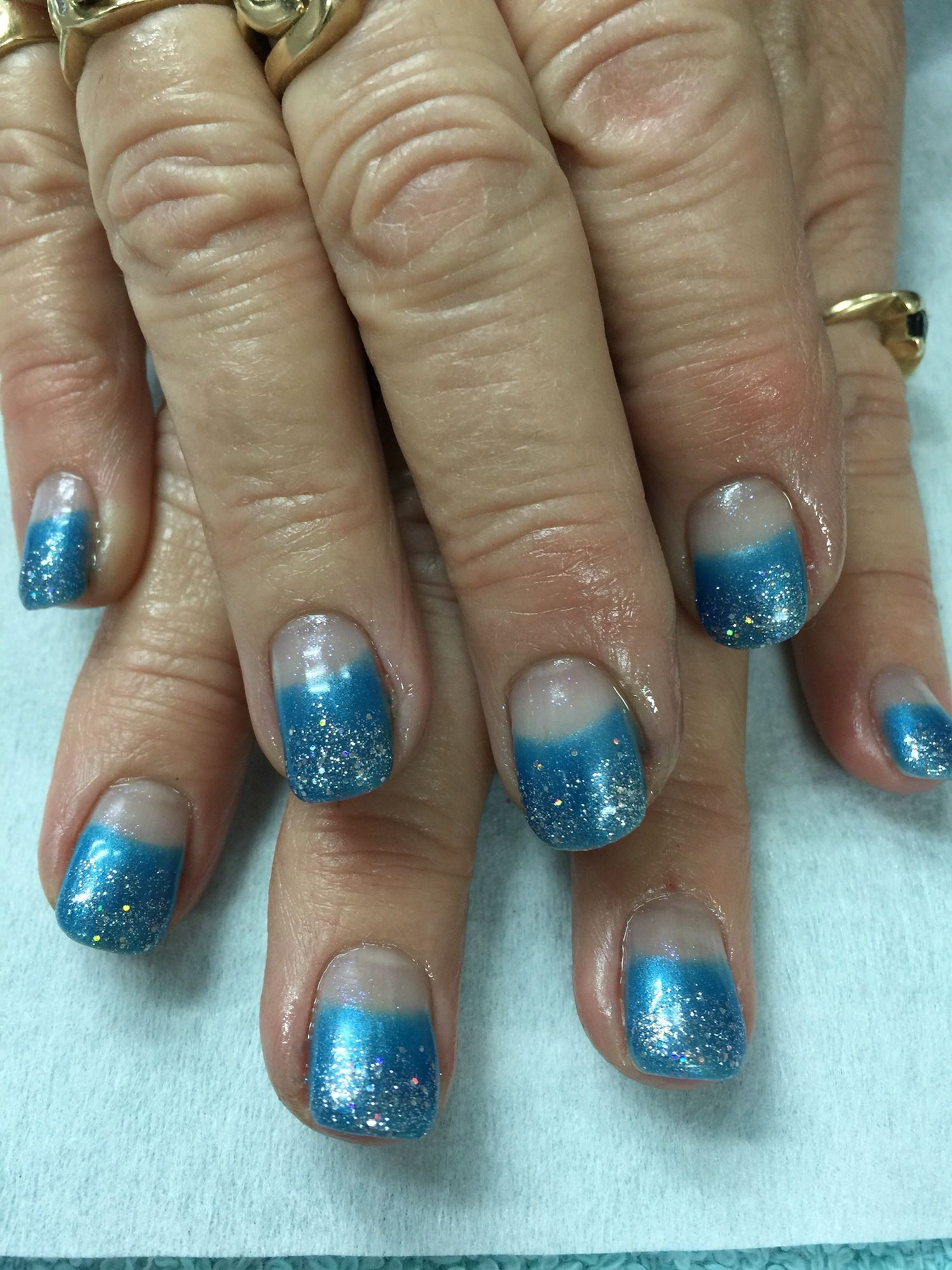 Blue High French Silver Glitter Gradient gel polish over non-toxic odorless hard gel nails.