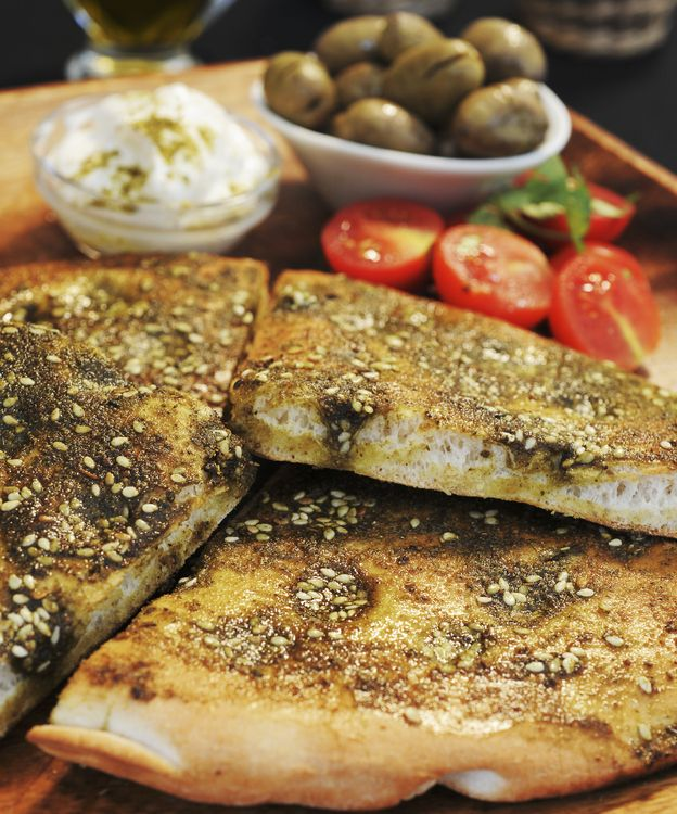 The linked article is about za'atar - an amazing spice mix. I brought some back from Lebanon when we were there. The fresh flat bread described in the article is called maneesh in Lebanon and is the top choice for snacking every day midmorining. (Lebanese bread topped with za'atar, a spice mix ubiquitous in the Middle East.)