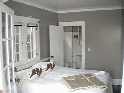 taupe/gray walls. dark floor. white bedding and dresser. paint trim ...