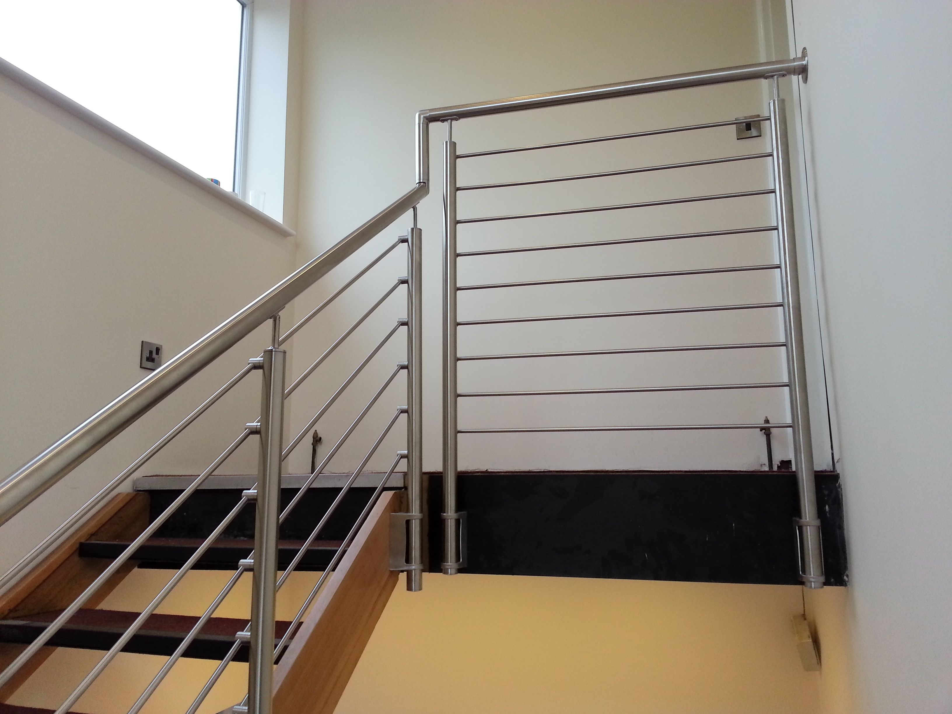 Stainless Steel Posts with a Bar infill provides a modern design for any  office space.