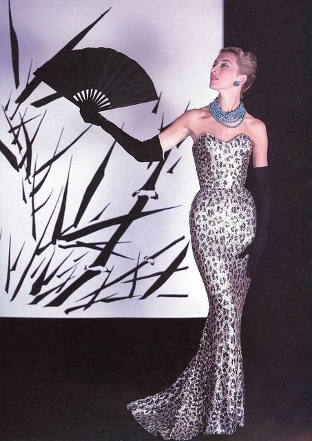 Marie-Thérèse in Balmain's famous sheath of embroidered pailettes in leopard spot design, photo by Philippe Pottier, 1953