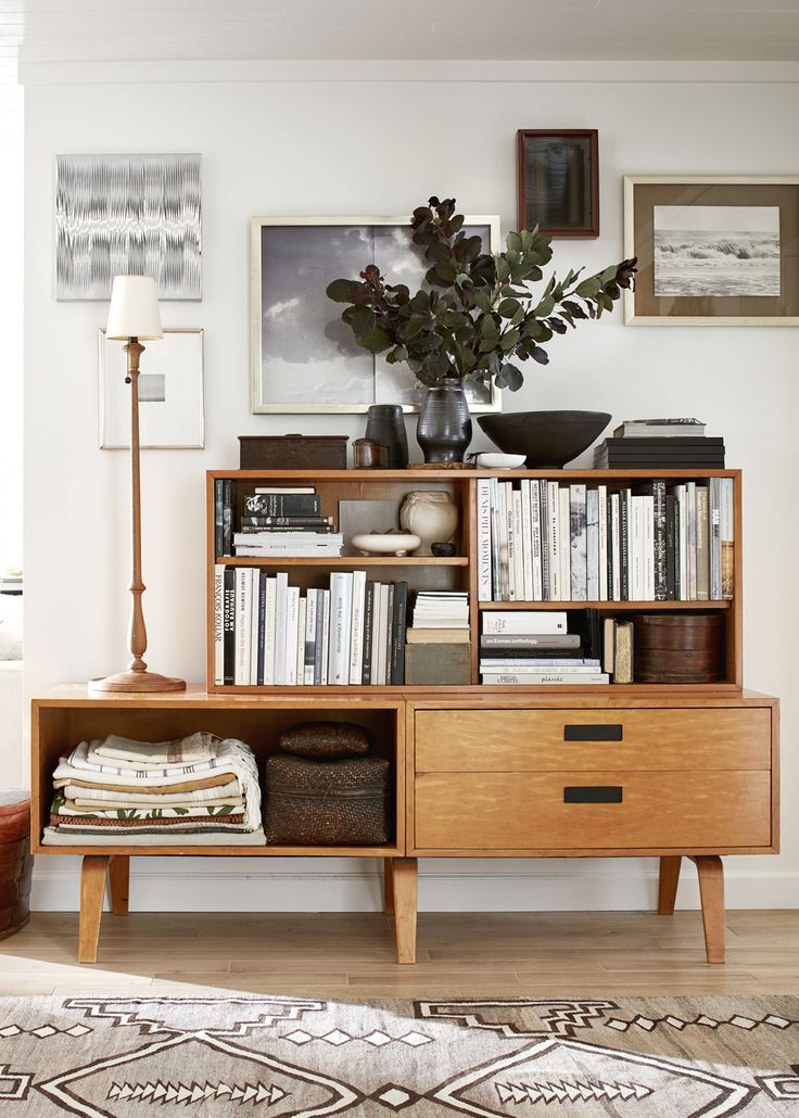 A midcentury furniture piece acts as storage for the entryway relaxed ranch house tour on