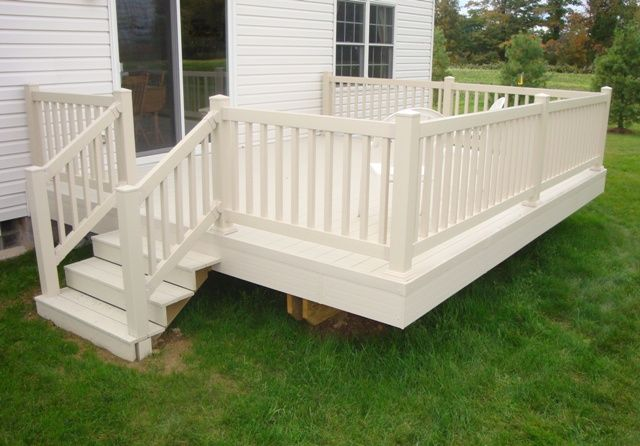 Off white rail, but a dark gray deck (pine painted deck 6 sides), Stairs on both sides. Skirted in.