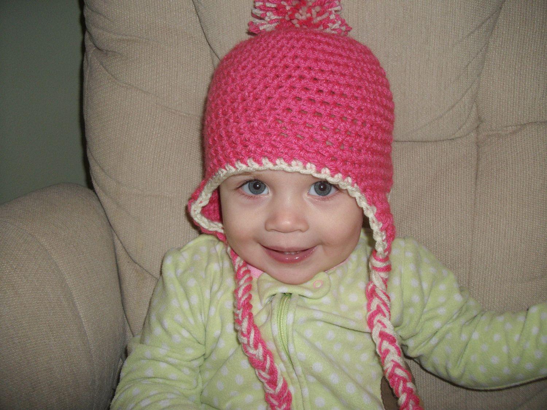Snowball Earflap Hat. $22.00, via Etsy.