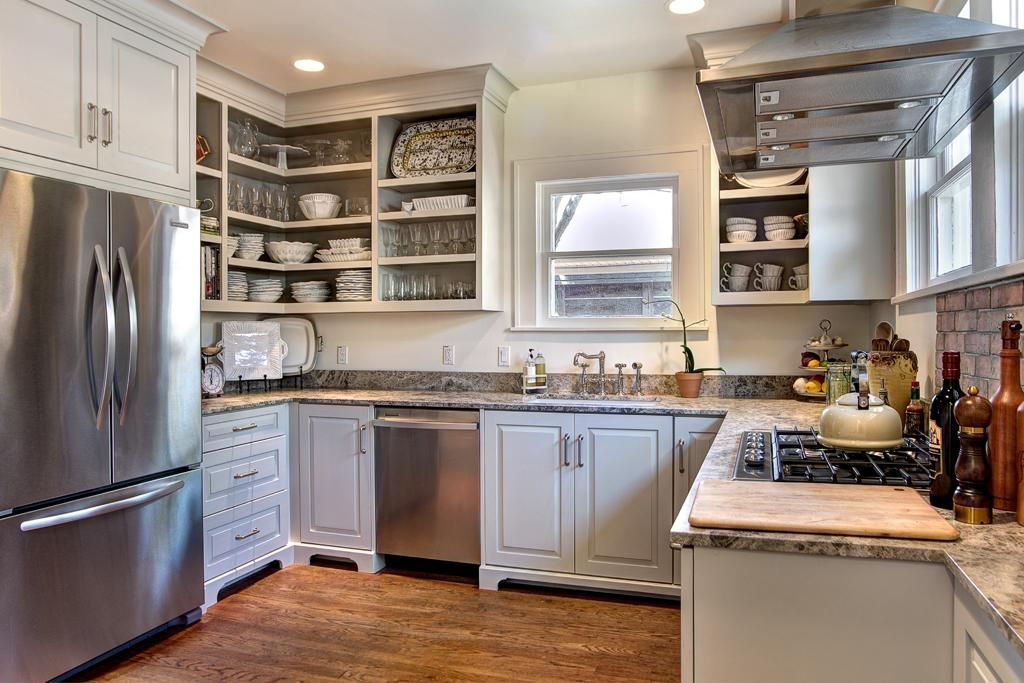 The Kitchen Is Just Darling Granite In Gray And White Cabinets