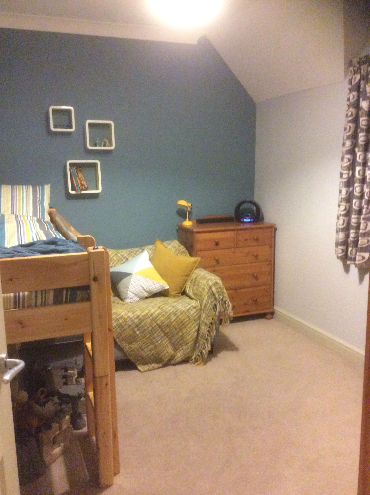 Boys bedroom with bright colours funky curtains from john lewis