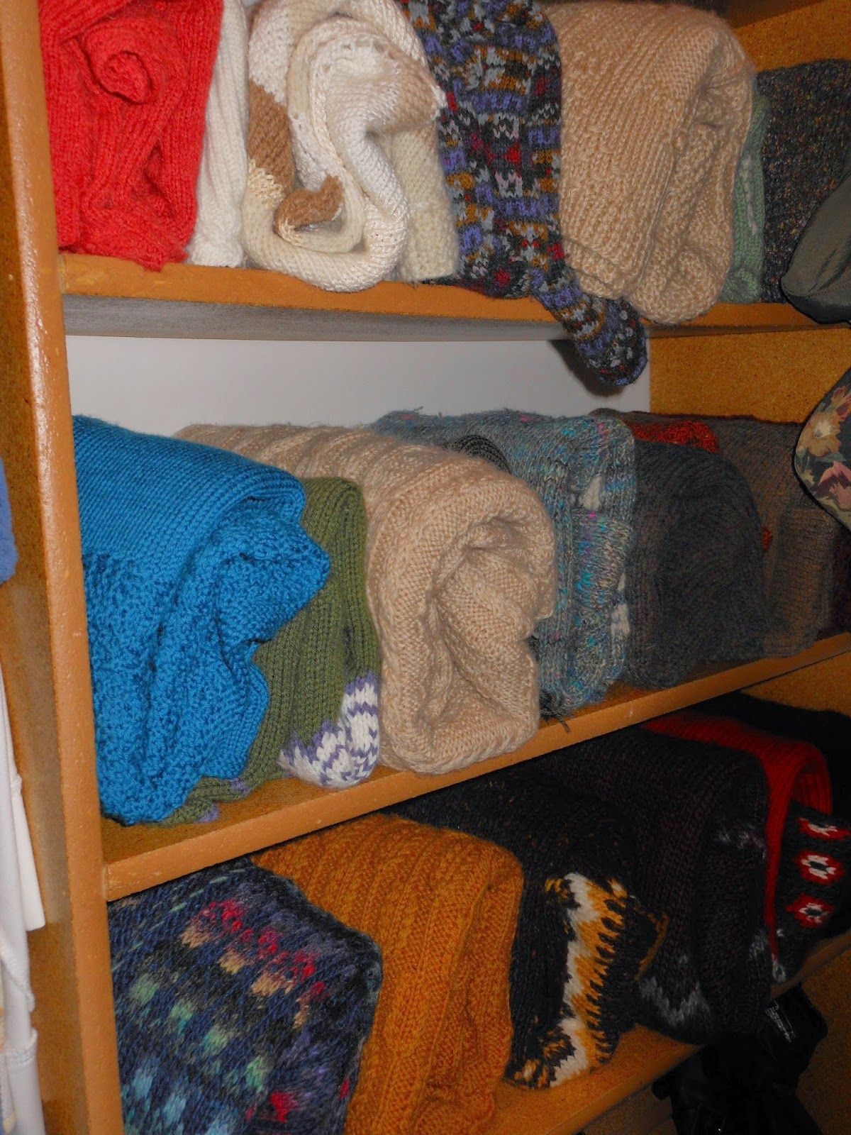 Konmari folded sweaters on shelves - source: I'm gonna ...