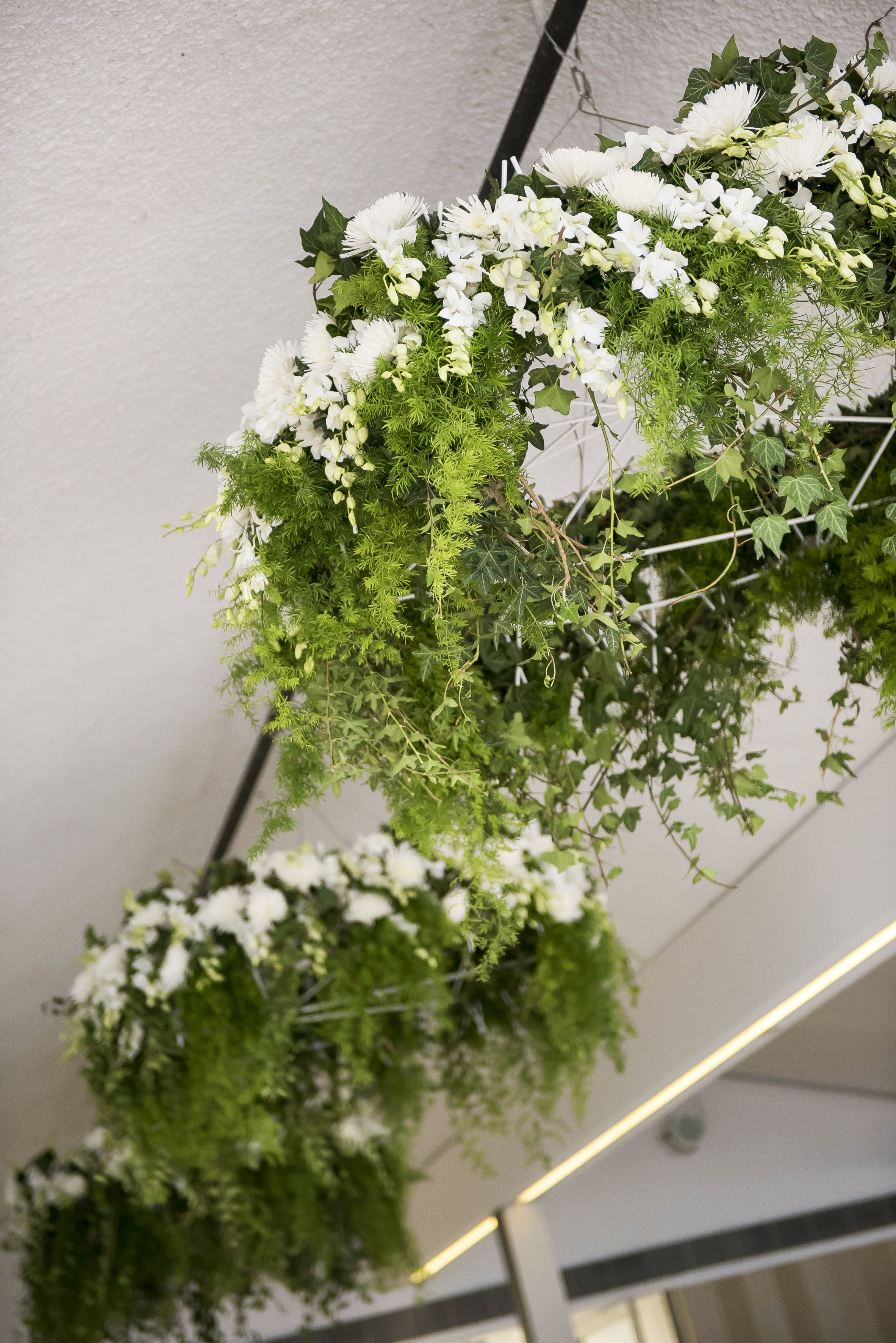 Greenery and white flora hung from ceiling , wedding decoration | itakeyou.co.uk