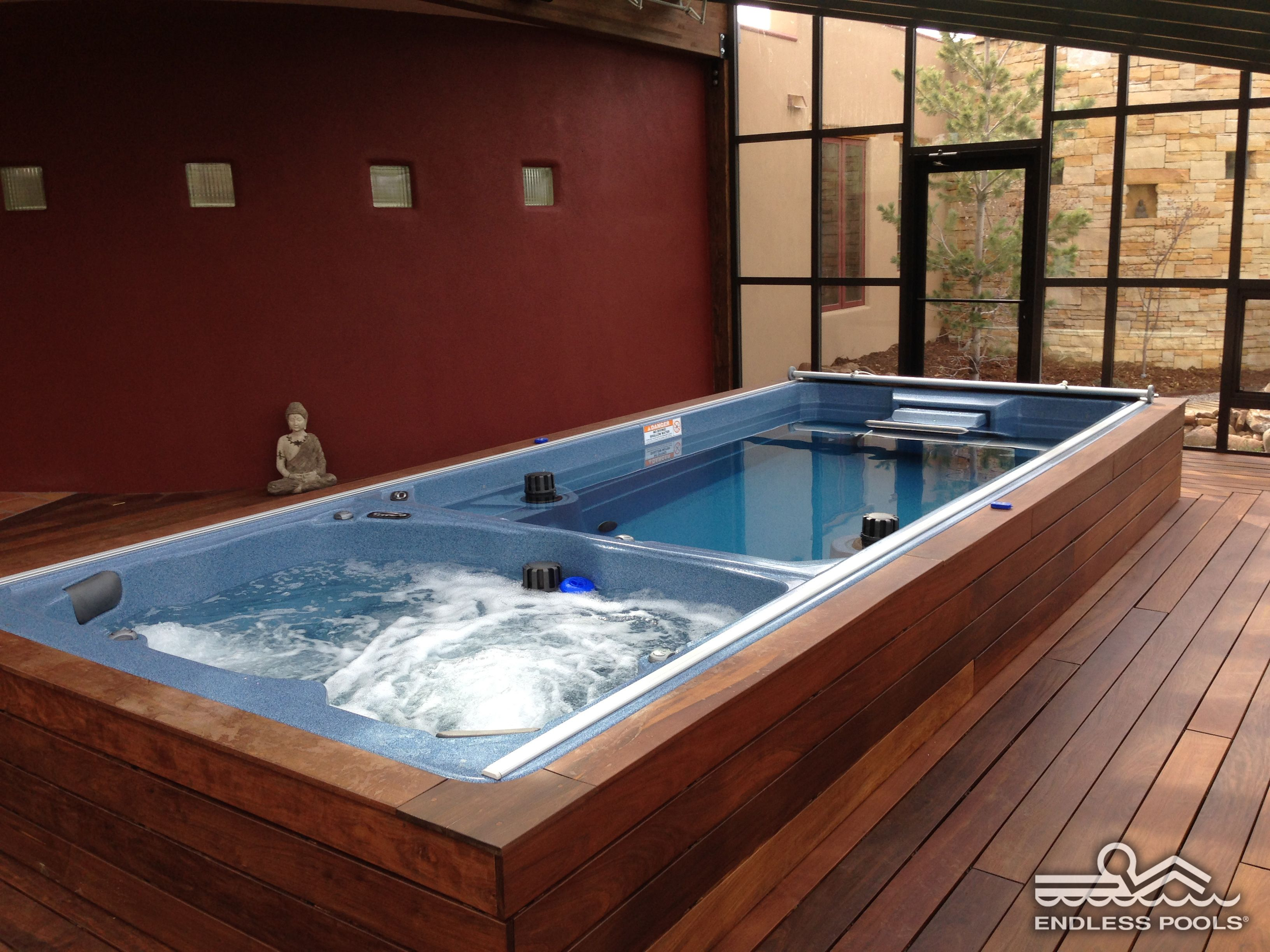 How zen would you feel in this endless pool swim spa for Basement swimming pool ideas