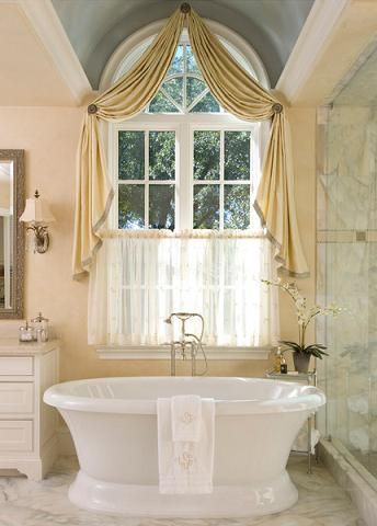 French country style bathroom with curtained windows for French inspired bathroom design