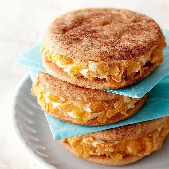 Cornflakes provide a pretty, crunchy edge to ice cream sandwiches! Find more surprising things to do with cereal: http://www.bhg.com/recipes/breakfast/10-surprising-things-to-do-with-cereal/?socsrc=bhgpin110914crunchtoicecreamsandwiches&page=6