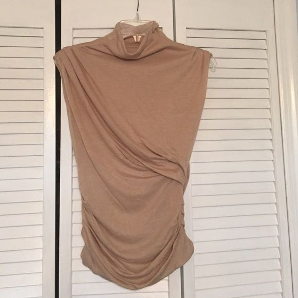 Ann Taylor top Super soft and chic AT top. Mock neck with cute side gatherings. Would look great with a skirt or jeans. Never worn Ann Taylor Tops