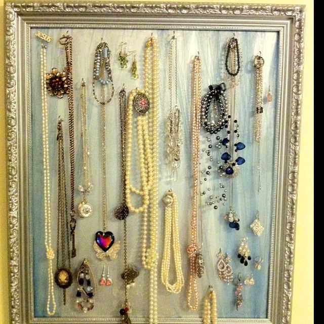 Nifty jewelry holder made from an old frame and repainted. Used tulle so I could hang earrings on it.