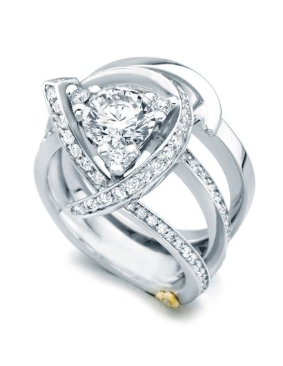 'Luxury' - LOVE how three small diamonds make the center stone into a triangle!