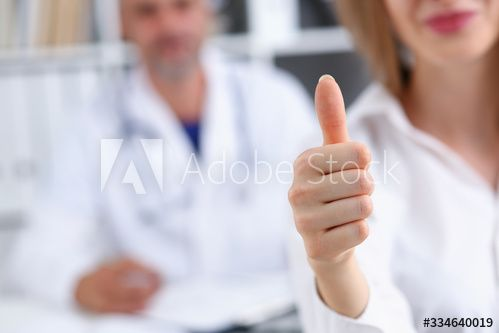 Arm show ok or confirm with thumb up at doctor office closeup. High level work confident satisfied client do like visit best occupation healthy life emergency help teamwork success concept - Buy this stock photo and explore similar images at Adobe Stock
