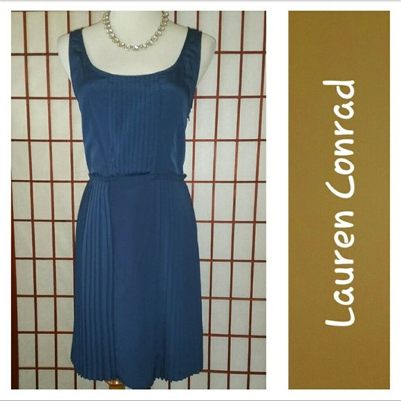 Perfectly Pleated! Beautiful blue dress by Lauren Conrad.  Accordian pleats.  Fully lined.  Sleeveless.  Dress up with heels and pearls, perfect for a wedding.  Dress down with flats.  You can't go wrong in the dress.  Side zipper.  Sz 8.  Measurements lying flat armpit to armpit 16in, waist 13in,  length shoulder to hem 33in.  Excellent condition.  No stains or tears.  From smoke free home. LC Lauren Conrad Dresses
