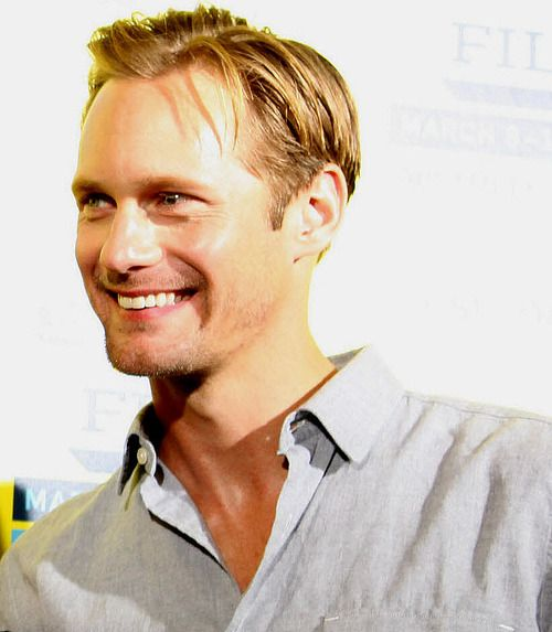 """Behind an L-shaped barricade, a breathless crowd waved True Blood DVDs and boasted how many hours they'd been waiting to gaze up at Skarsgard with grateful eyes. He worked his way up from the back of the line, accepting hugs, signed autographs, taking pictures with young women who had driven into town from Dallas and Houston. """"He's the most accommodating actor I've seen come through here all week,"""" a SXSW volunteer staff member said. """"I can't believe he went all the way down the barricade…"""