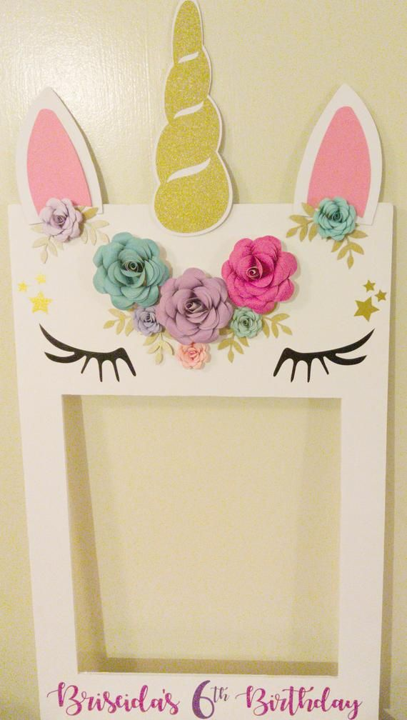 """Unicorn Photo Selfie Frame   Photo Prop  Unicorn Party Decorations Bridal Showers Birthday - Unicorn birthday party decorations, Unicorn party decorations, Unicorn birthday parties, Unicorn themed birthday party, Unicorn theme party, Unicorn themed birthday - 2  heavy duty 20  x 30  Foam Board  The inside dimensions are 20""""x14"""" Perfect size to fit 23 people Flowers are made of heavy, highquality cardstock  11 5  Glitter Gold Unicorn HornUnicorn EarsGlitter EyelashesComes personalized and assembled (Horn and ears will be removed for shipping  Velcro attached, for easy installation )Would you like a frame to match your event  Send me a convo and I will create something special made to order, just for you! Please allow 12 extra business days for custom orders"""