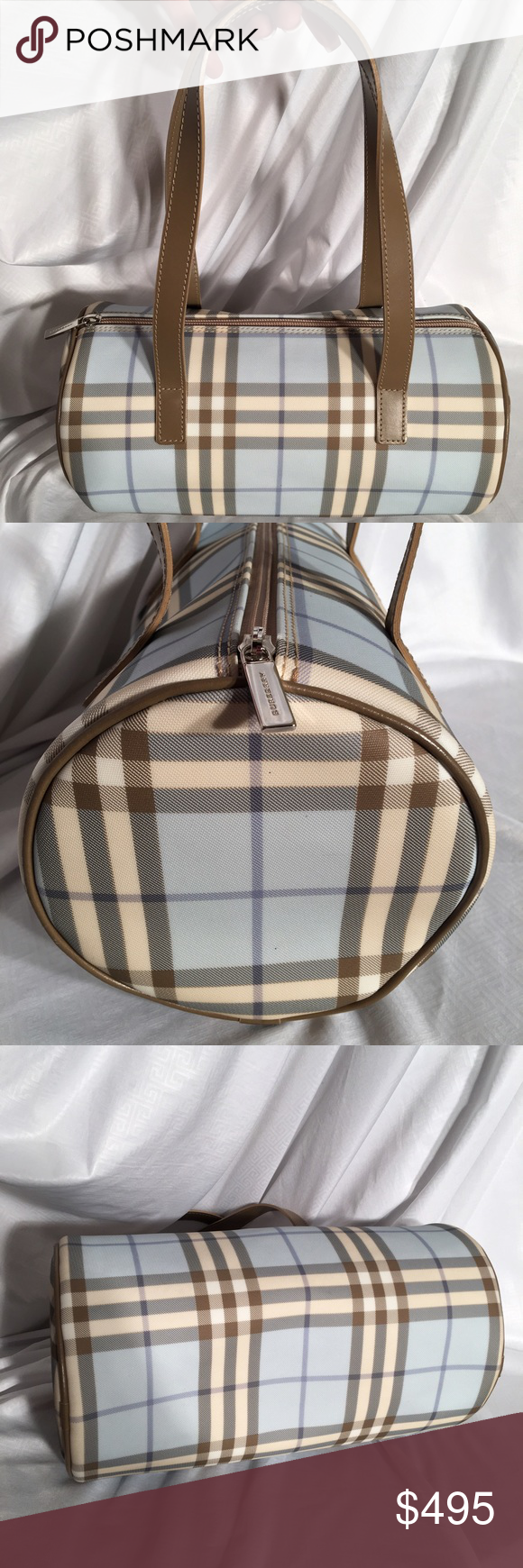 Burberry Absolutely Beautiful Baby Blue Nova Check Burberry Absolutely Beautiful Baby Blue Nova Check Barrel bag, virtually brand new. I cannot find any markings or imperfections at all. 11.5 inches wide X 6 inches deep x 6 inches high. Burberry Bags