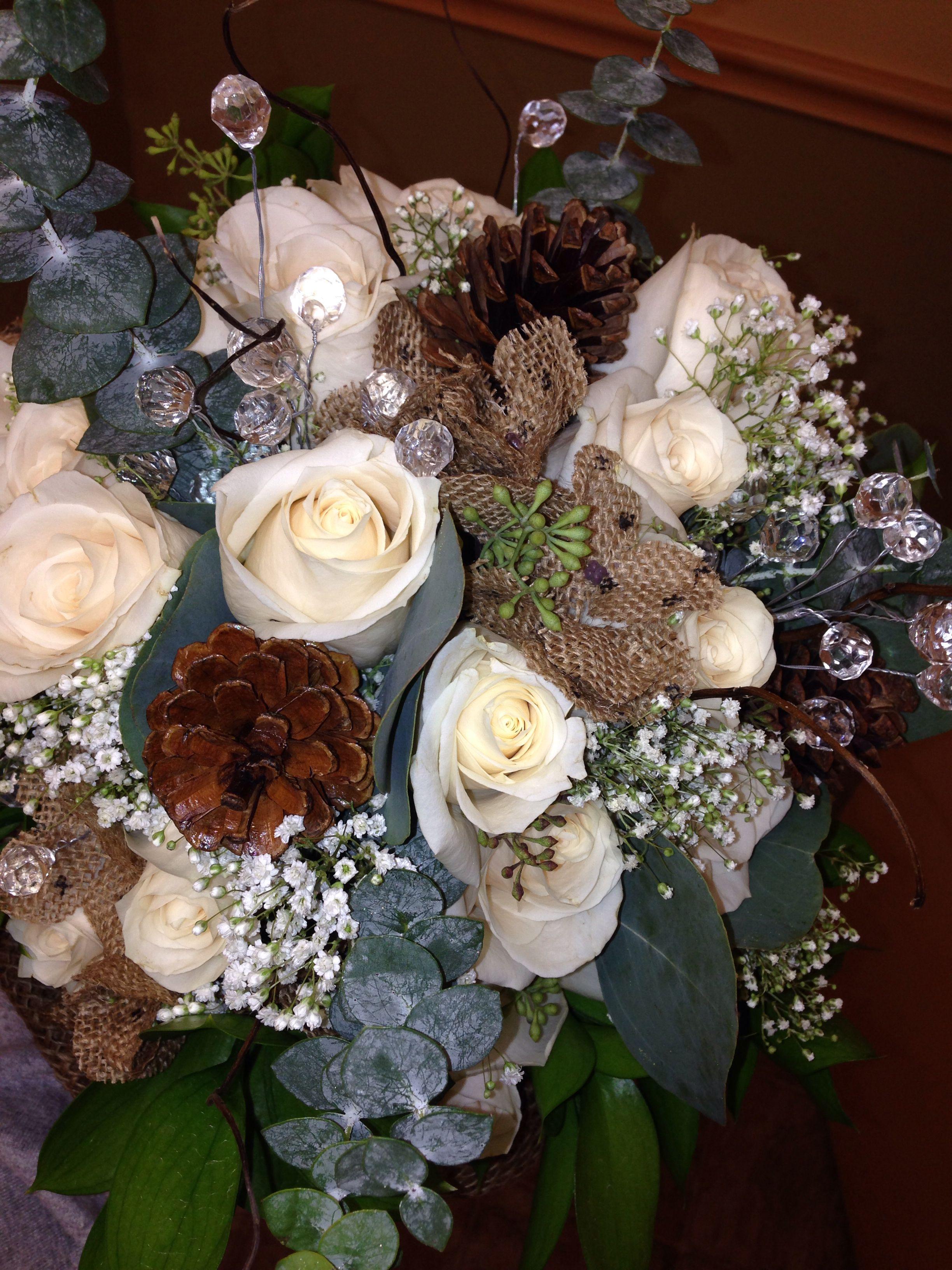 Pinecone, eucalyptus, and rose bouquet