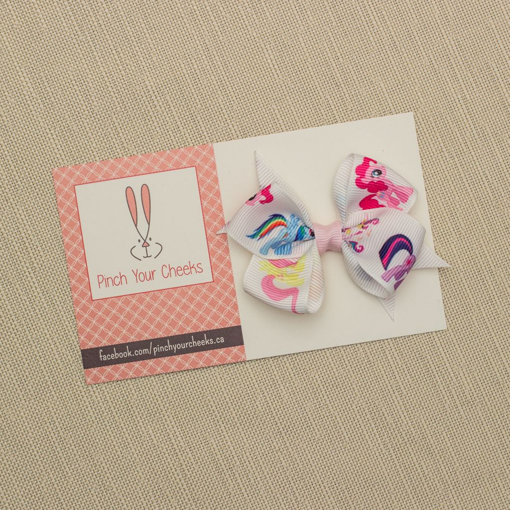 **Limited quantities** Medium printed #hairbow $4.00 each | #mylittlepony print #bow with a #lightpink centre. The bow is attached to an #alligatorclip partially lined with light pink grosgrain ribbon. All #hairbows are #handmade in #yyc. For more #cute #hairaccessories for #babies, #toddlers & #girls of all ages visit our facebook page: facebook.com/pinchyourcheeks.ca