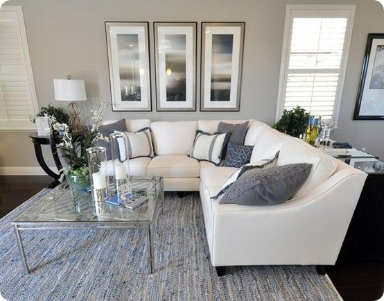that sectional! grey living room dark carpet light grey walls
