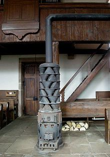 fireplace water heat exchanger. 18th century cook stoves  Alsatian stove with large exhaust gas heat exchanger in Fouday