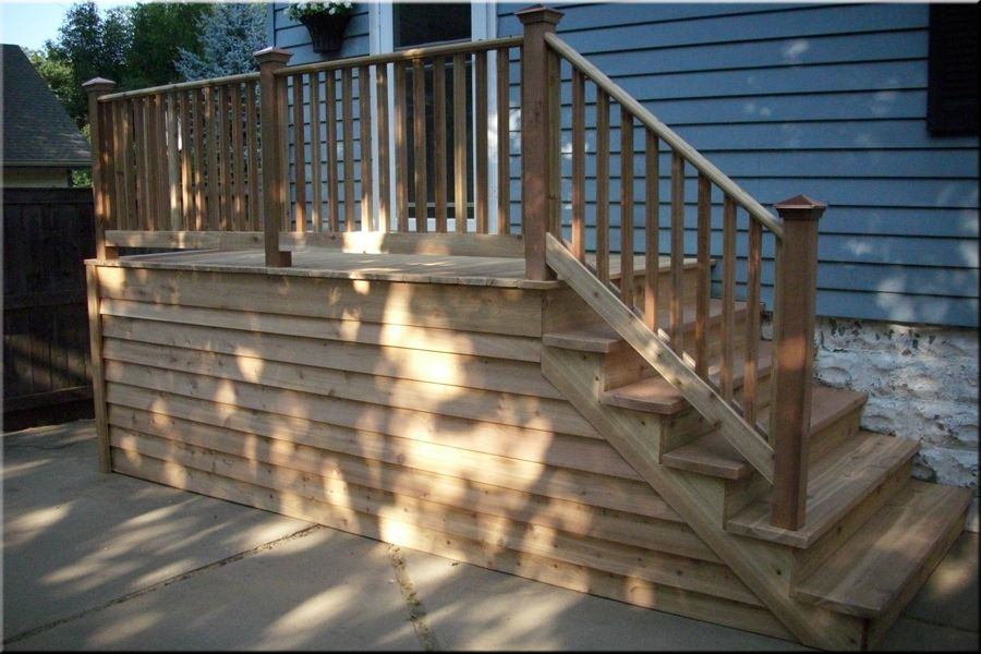 Small deck landing porches decks patios projects for Wooden front porch steps designs