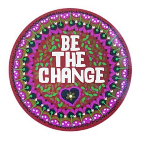 Cheery car magnet with fun bright flower design and be the change decorated on red background