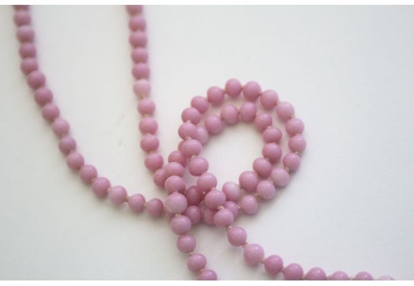 """Vintage Beaded Necklace c.1920's $80.  Pink glass bead flapper necklace. Hand-knotted between each bead. Length is 28"""""""