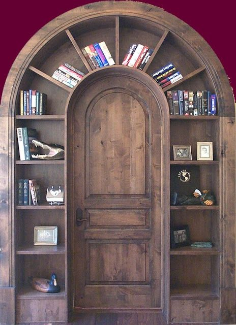 Not only is it clever use of doorway space, but it looks lovely. Also it really makes me want to have an arched door!  ---  Arched Bookshelves