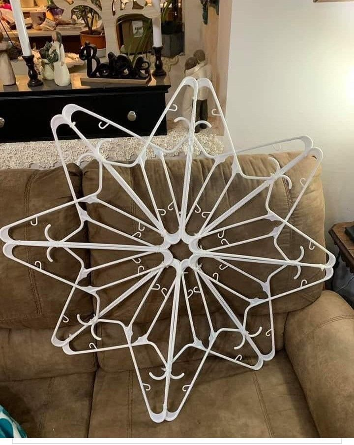 Snowflake made from plastic hangers Glam christmas decor