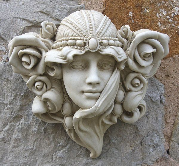 have a look at this art nouveau face wall ornament page from the art nouveau wall plaques. Black Bedroom Furniture Sets. Home Design Ideas