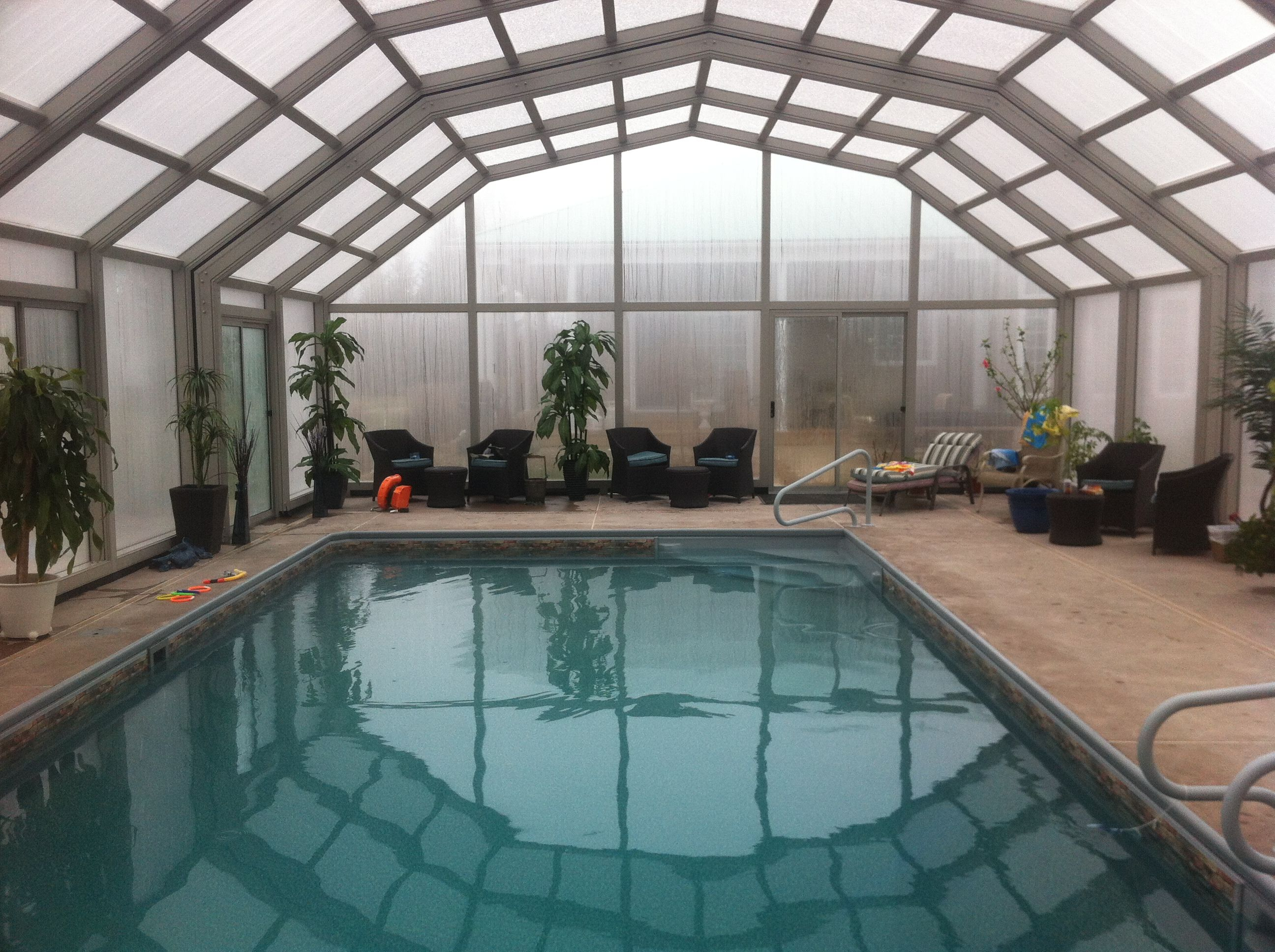 Covers In Play S Retractable Pool Enclosures Keep It Warm All Year Round Pool Enclosures Indoor Outdoor Pool Swimming Pool Enclosures