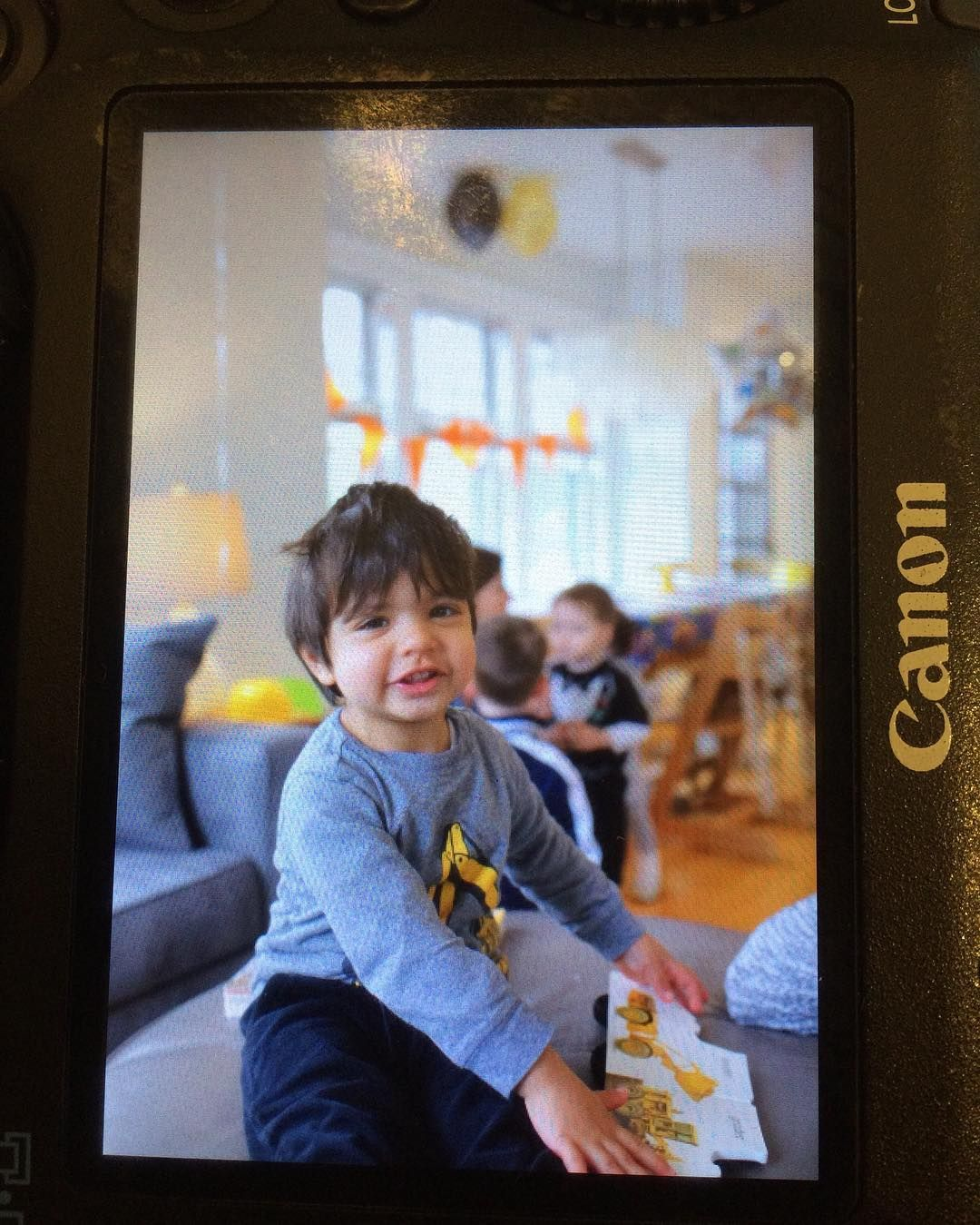 The birthday boy! (Wish I could find this digger shirt in bigger sizes - he wants to wear it all the time!) #julian #birthdayboy #birthday #two #toddler #growingup #backofcamera #canon #sigmaart35mm