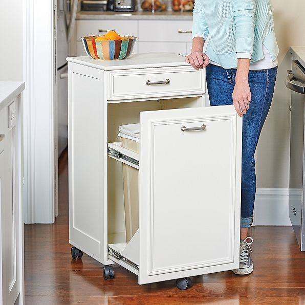 You D Never Guess That You Could Hide A Wastebasket Inside This Beautiful Kitchen Cabinet But You Can White Storage Cabinets Minimalist Cabinet Cabinet