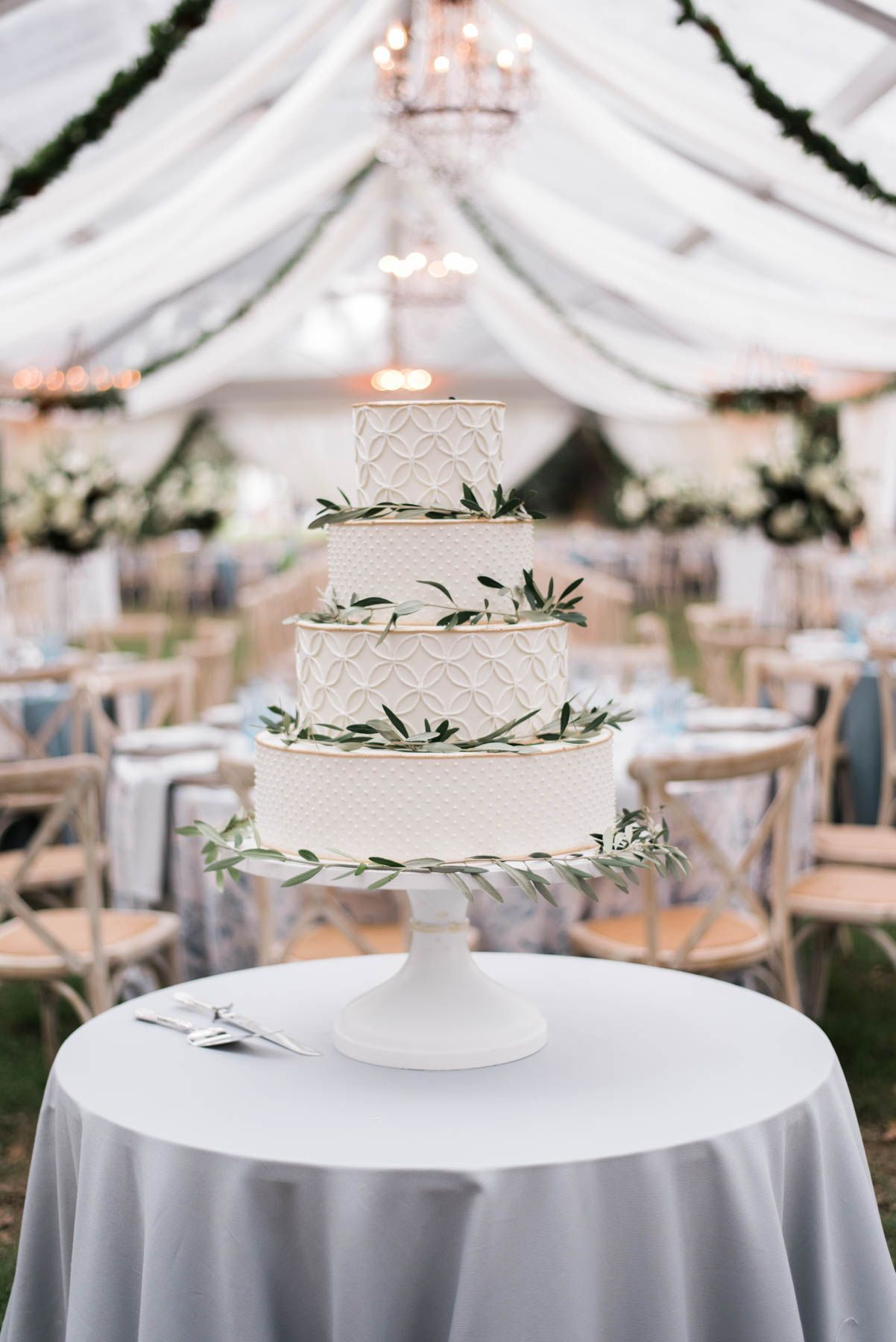 Ideas for an all white simple and classic tiered wedding cake for