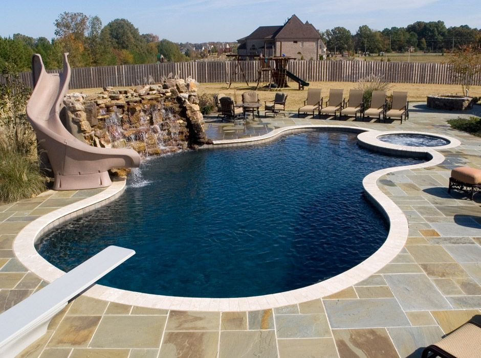 Freeform Swimming Pool With Water Wall Slide Diving Board And Spa Backyard Ideas