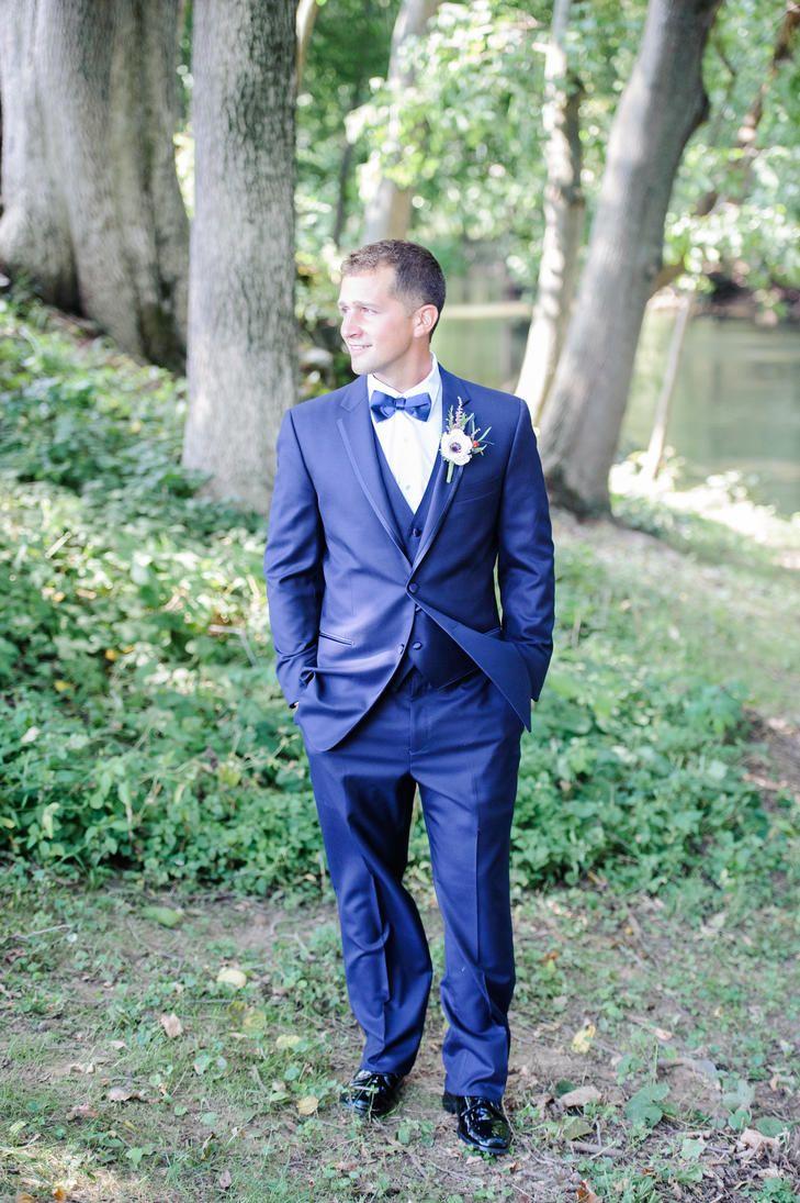 Navy blue grooms tuxedo and bow tie photo olivia rae