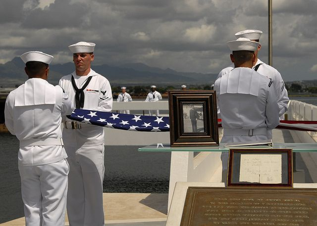 Joint Base Pearl Harbor-Hickam's Honors and Ceremonial Guard participates in an ash scattering ceremony for retired Chief Petty Officer Earl Selover at the USS Utah Memorial on Ford Island. Chief Selover's remains joined the remains of more than 50 Sailors still aboard the USS Utah (BB 31) wreckage which was sunk during the 1941 attacks. (U.S. Navy photo by Mass Communication Specialist 2nd Class Tiarra Fulgham/Released)