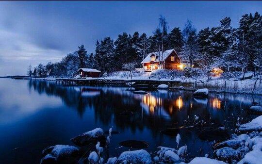 Winter scene of cabin on the lake - Sweden