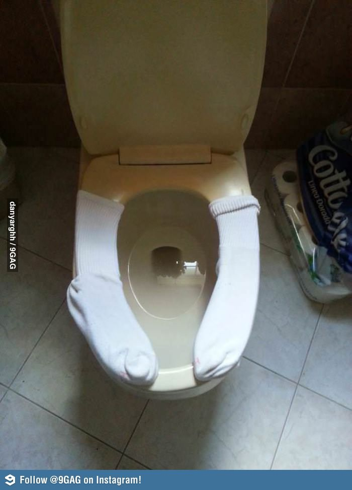 Keeping The Toilet Seat Warm With Socks Funny Pictures Laugh