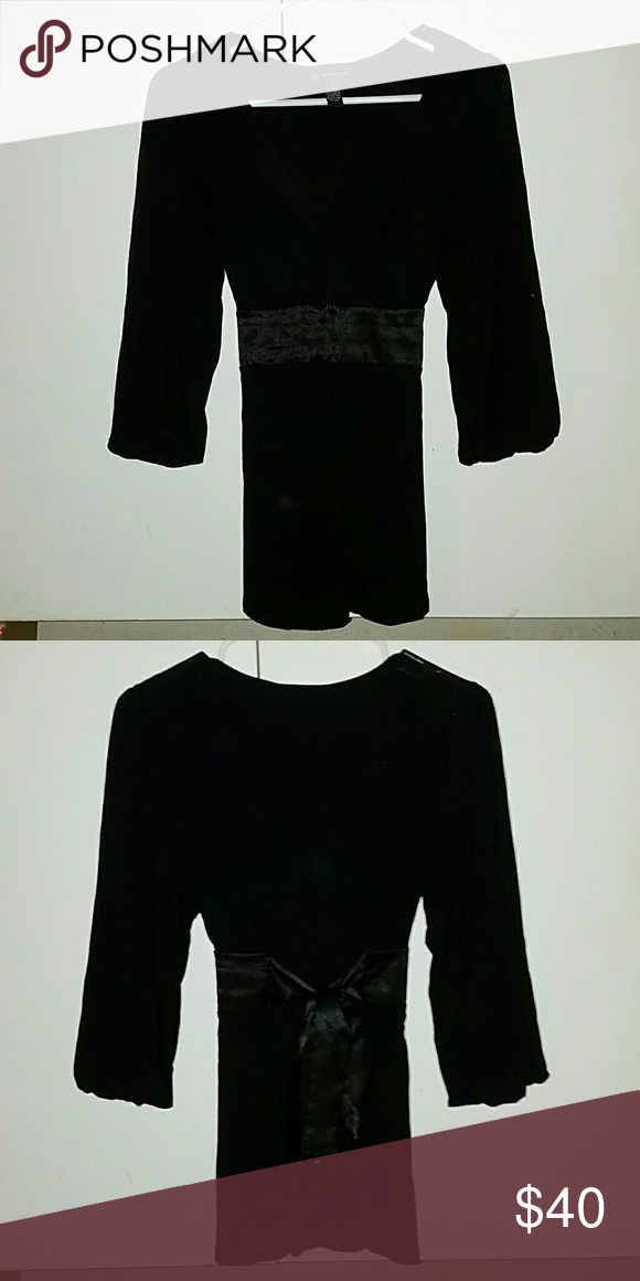 Absolutely Stunning Black Sash Blouse nwot Stunning Blouse by INC. With v neck and Adorable shining sash that ties in the back and makes a beautiful bow!! #precious #unique #classy #bebe #guess Perfect condition. New without tags. INC International Concepts Tops Blouses