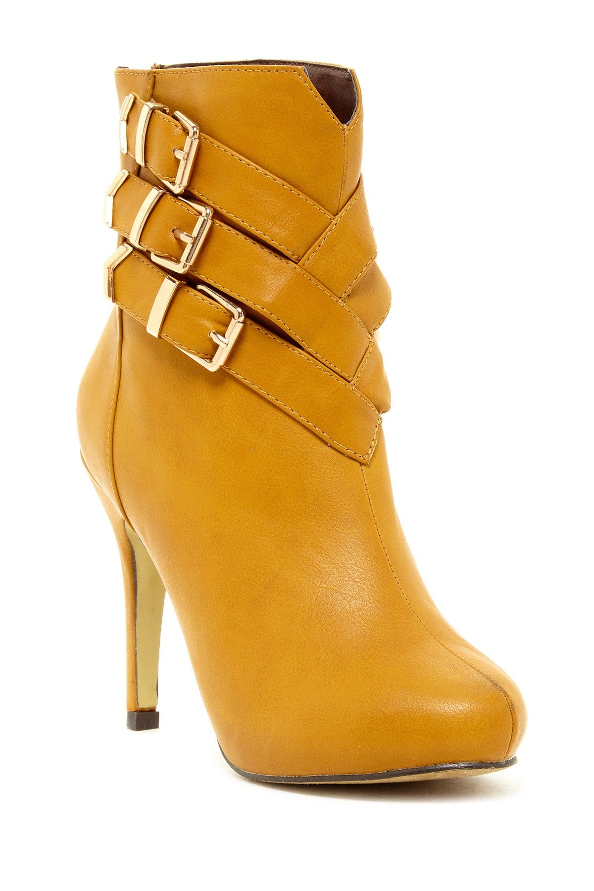 Awesome asymmetrical buckle design detail on these booties