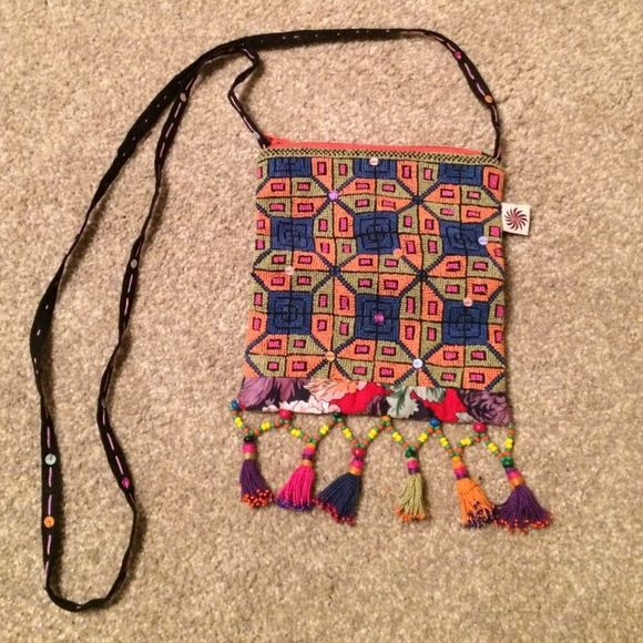 Handmade Purse from Eygpt This purse was beautifully crafted by women in Egypt. It has a woven design with sequin accents throughout the purse and strap. Truly one of a kind!! Bags Shoulder Bags