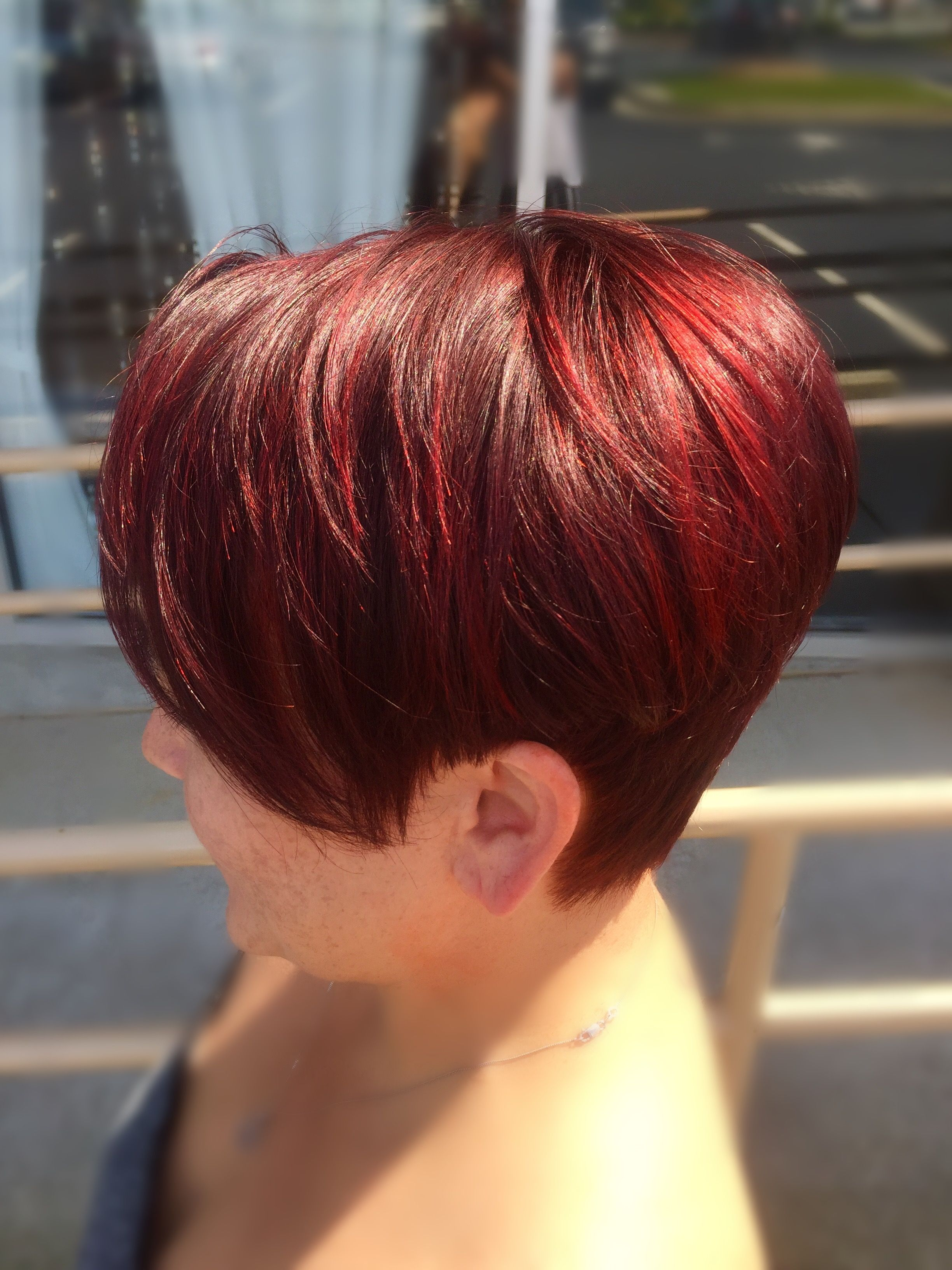 red hair pixie cut short hair bright red red violet redken