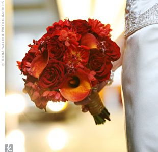 Burnt Orange Calla Lilies Deep Red Dahlias Roses And Oncidium Orchids With Rosemary Accents