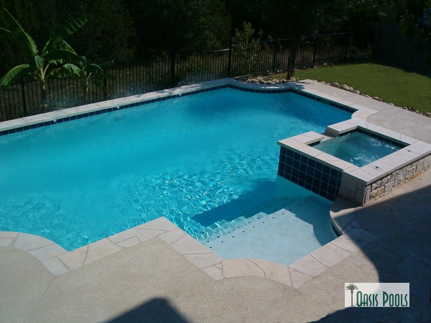 Grecian shape with spa steps and splash ledge on one for Pool design for volleyball